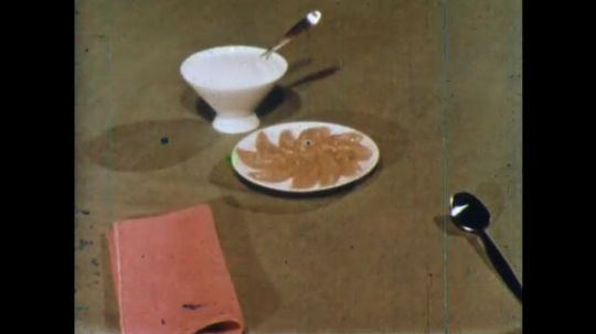 UNITED STATES 1960s: Foods appear on table / Pan across kids