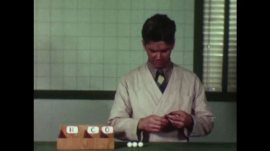 UNITED STATES, 1950s: Scientist builds molecular model from beads.