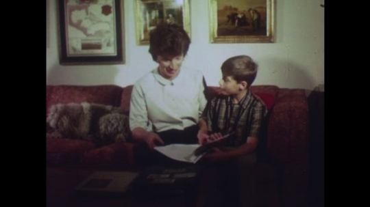 UNITED STATES: Mother shows boy chapter in book called,