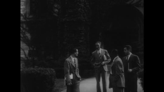 UNITED STATES, 1940s: Suited men talk outside church. People leaving a building. Groups walks through park. Men read