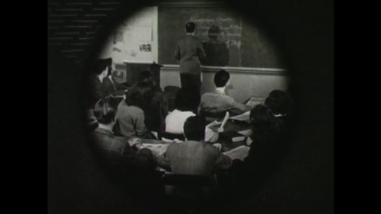 United States, 1940s: Man teaching in a classroom. Diagram of enlightenment. Image depicting shared respect. Hands voting at a poll. Democracy title.