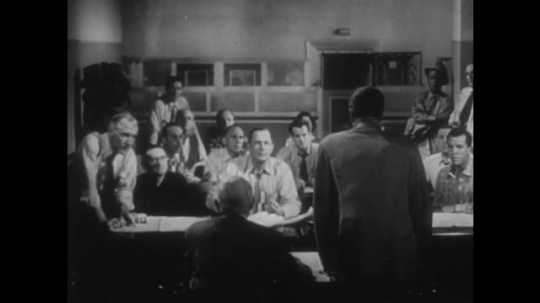 UNITED STATES, 1952: Businessman speaks in front of committee.