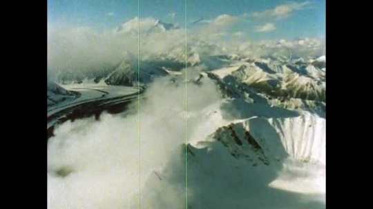 ALASKA, UNITED STATES: 1980s:  View from above Denali. Snow covered Denali mountain