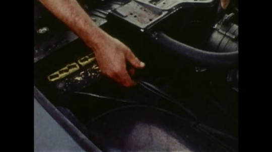 UNITED STATES: Attendant checks appearance and placement of battery.