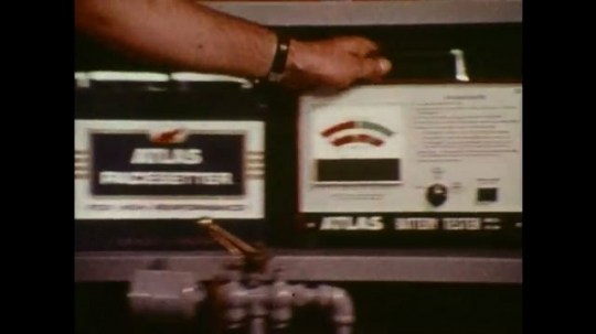 UNITED STATES: Attendant tests battery using Atlas tester.