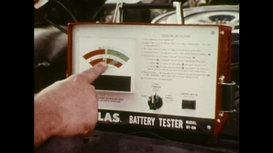 UNITED STATES: Attendant explains to customer that a replacement battery is necessary.