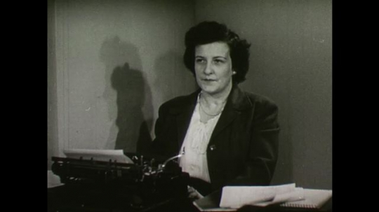 United States, 1940s: Secretary looks annoyed as she sits at desk. Reservation ticket for a vacation. Vacation ticket with question about the number of Hebrews travelling. Building with a small spire.