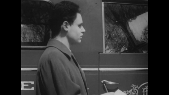 UNITED STATES, 1948: Flashback of teen boy interviewing chief about fire engine.