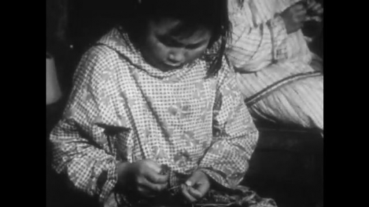 UNITED STATES 1940s: Girl sewing / Close up, hands sewing / Girl sewing.