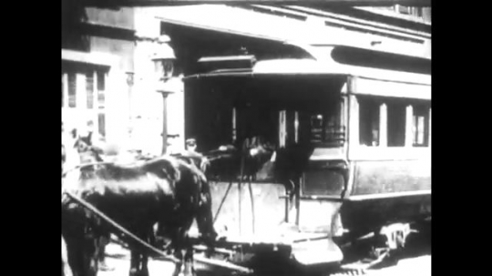 UNITED STATES 1890s: View of horse-drawn trolley / Intertitle / View of street scene, trolley drives down street.