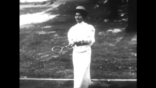 UNITED STATES 1890s: Woman serves ball / Man hits ball / Close up, man serves ball / Referee on sideline / Intertitle / Woman hits ball / Close up of racket / Man hits ball.