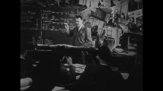 UNITED STATES 1940s: Teacher lecturing in classroom / Man welding metal structure / Man looking through viewer / Man drawing on blueprint.