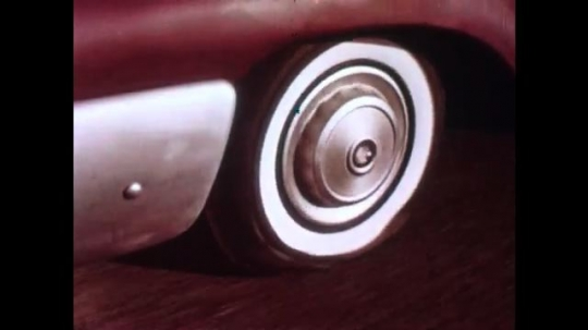 UNITED STATES: 1940s: Speeded up car driving with a puncture. Man talking to camera. Inside of rubber tyre. Upside down car. Speedometre and reverse film footage of crash.