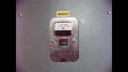 UNITED STATES, 1970s: Emergency button on a machine. Cables and wires connected to a machine. Heart monitors plugged in to a wall.