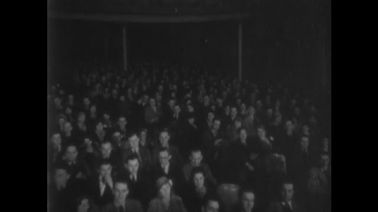 UNITED STATES, 1930s: People sat in audience in theatre. Audience applauding. Knowledge Builders Credit Slide.