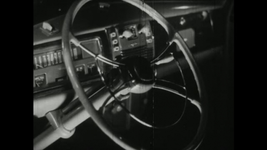 UNITED STATES, 1940s: steering wheel of car. Cotton. Man unloads stack of cotton into vat.