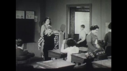 UNITED STATES: Students enter classroom and camera focus in on one boy.