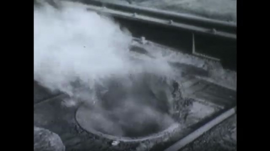 UNITED STATES, 1940s: Close up of chutes on fire as man puts out flames. Men putting out flames inside chute.