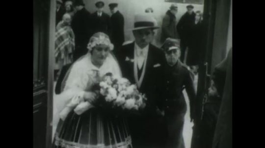 POLAND, 1950s: Bride enters church. People walk through field. Couples link arms and walk outdoors.