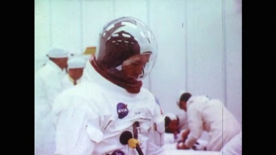 Astronaut Wearing NASA Suit on Earth. Astronauts in Science Lab Having Suits Tested. Astronauts Give Feedback About Suits to Scientists in Lab