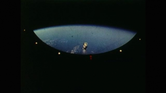 View of the Earth as Space Rocket Splits into Two. Space Rocket Releases Second Section and Causes Sparks to fly. Men Working on Special Computers at NASA Ground Control.