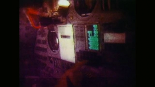 Astronauts Pressing Buttons Inside Space Capsule. Star Chart Inside Space Capsule. NASA Astronauts Inside Space Capsule