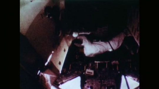 Astronauts Working Inside the Space Capsule.