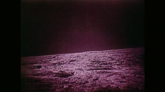 View Across the Surface of the Moon. View of Astronaut by Steps of Space Vehicle.
