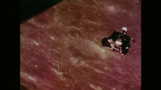 Space Craft Travelling Above the Surface of the Moon.