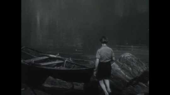 NORWAY 1950s: Man and boy get into boat, paddle into lake / Woman making pie in kitchen with boy, boy picks up basket of eggs.