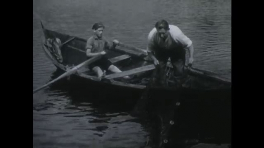 NORWAY 1950s: Man and boy in boat, man pulls up net / Boy hands basket of eggs to girl, boy and girl get into boat.