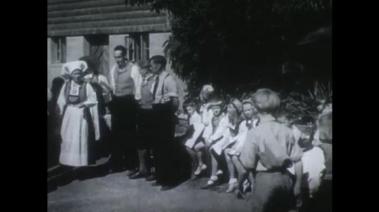 NORWAY 1950s: Groups of people greet each other outside house / People shake hands / Boy and girl walking / Couples dance.