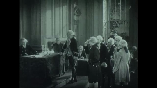 UNITED STATES 1940s: Men in period costume in meeting / Animation of constitution, article zooms forward / View of castle, title on screen / Text on paper / Soldiers on horseback exit building.