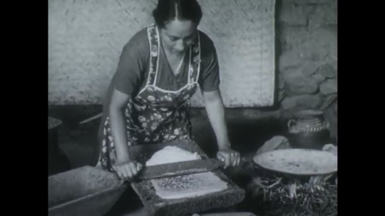 MEXICO 1950s: Woman takes grinded corn and forms a dough.