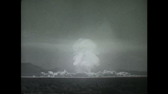 UNITED STATES: 1950s: Drawing of a cloud forming after a nuclear explosion. Drawing of particles inside a radioactive cloud