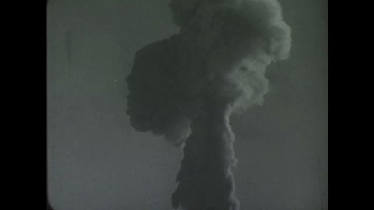 UNITED STATES: 1950s: Footage of a radioactive column of particles and cloud.