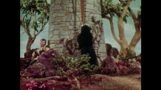 UNITED STATES: 1950s: Witch climbs up Rapunzel