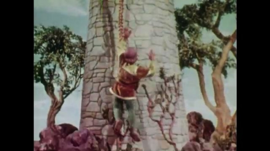 UNITED STATES: 1950s: Young man slides down Rapunzel