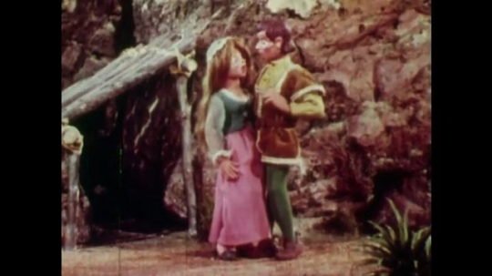 UNITED STATES: 1950s: Rapunzel's hair grows back after witch cuts it. Castle on a hill top.