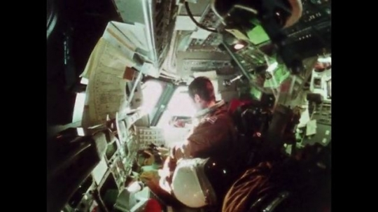 UNITED STATES: 1981: Astronaut working in cabin of space shuttle as it travels through space. Astronaut