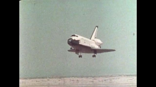 UNITED STATES: 1981: Space shuttle lands on sandy runway.