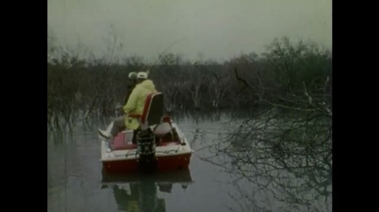 UNITED STATES: 1980s: men fish from boat on water