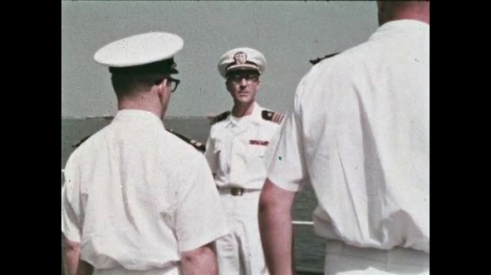 UNITED STATES: 1968: Sailors on deck of military ship. Man salutes