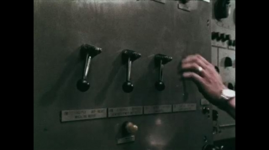 UNITED STATES: 1968: hand turns levers on machine. Sailor operates dashboard on ship. Sailors operate equipment on ship.