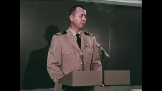 UNITED STATES: 1968: man in uniform lectures from podium.