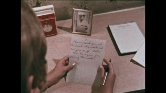 UNITED STATES: 1968: lady writes letter to sailor. Close up of hand writing a letter.