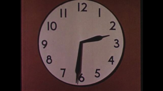 UNITED STATES 1960s: Clock face, hands move on clock.