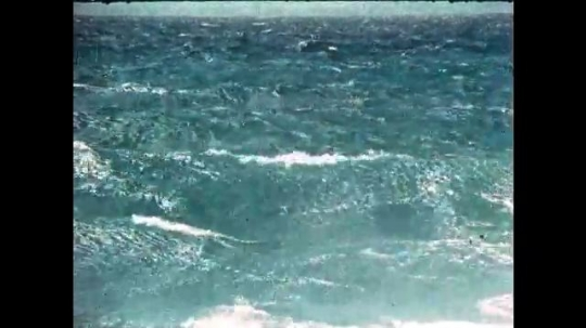 UNITED STATES, 1950s: Waves on the ocean. Water in a fountain.