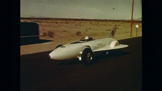 UNITED STATES: 1960s: Firebird One car on test road. Research bus and turbo cruiser bus on tracks.