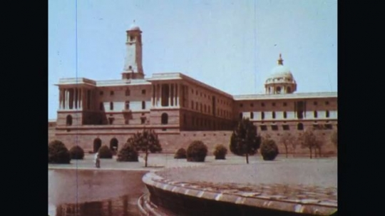 INDIA: 1960s: view of building from behind fountain and water feature.